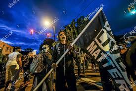 man mask holds Black Lives Matter flag Editorial Stock Photo - Stock Image    Shutterstock