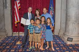 inside look at angels in adoption photo essay congressional above the dille family receives their specially designed angels in adoption pin and certificate from senator david vitter r la