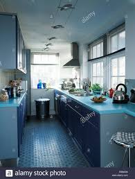 Rubber Flooring For Kitchen Rubber Flooring In Modern Galley Kitchen With Pale Blue Worktops