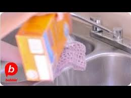 a sink with baking soda and vinegar