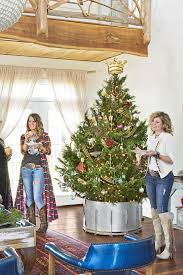 Creative christmas tree toppers ideas try Christmas Trees Country Living Magazine 35 Unique Christmas Tree Toppers Cool Ideas For Tree Toppers