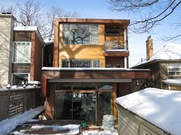 woodside residence was renovated to include a third floor addition the new space included a new master bedroom and ensuite bathroom with a small porch