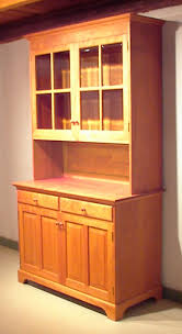 cherry china hutch with optional glass shelf and lights in upper cabinet