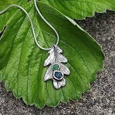 raw stone emerald oak leaf necklace