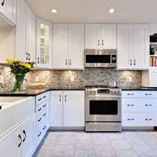white cabinets with the multi backsplash dark counters and gray white kitchen cupboards with black countertops