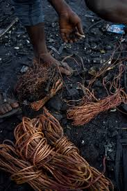 agbogbloshie scenes from a ghanian riot one man s story of life awal mohammed sorts through some bundled copper reclaimed from electronic waste