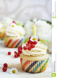 Candle Light Bakery Gentle Cupcake With Cream And Berries Nd A Candle A Light