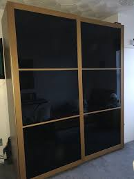 details about large ikea pax wardrobe oak coloured with black glass sliding doors rrp 550