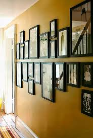 Plan your arrangement before you hang the photos