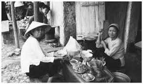 culture of vietnam history people clothing traditions women two women sit down to breakfast in vietnam while women have a strong role in