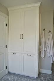 bathroom storage tall cabinet. install tall cabinet instead of built out closet for linen bathroom storage 4