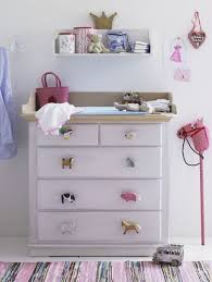 Wooden animal puzzle pieces as drawer handles for a kid's dresser - Creative  DIY Drawer Pulls - via athomeinlove via