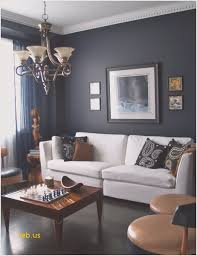 Living Rooms With Dark Navy Blue Walls With White Sofa And Classic  Chandelier