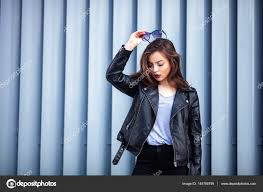 fashion hipster woman posing outdoor leather jacket brunette hair bright red lips