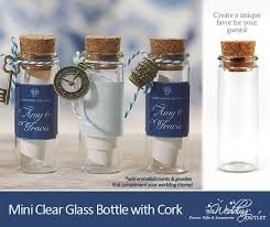 clear glass bottles in mini size with corks : perfect favor packaging for  the #DIY