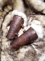 photographer photographer heavyweight leather bracers with tooled viking compass and fur made from 10oz veg tan leather and faux fur