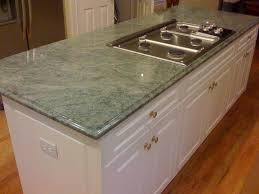 green granite countertops with white cabinet