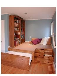 A platform in a storage/guestroom hides away all of your stuff while  keeping the