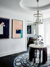 rose bay house greg natale abstract silver metal sculpture on center table in foyer large abstract pink and black geometric artwork paintings on white