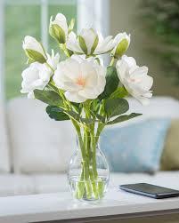 White silk magnolia accent set in clear acrylic water. Magnolia Silk Flower  Arrangement CREAM