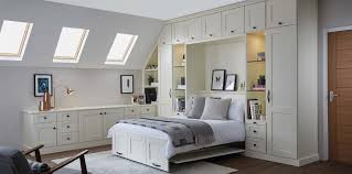 white bedroom furniture featuring a convenient pull down double wall bed