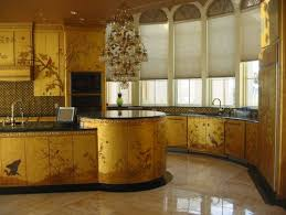 So tone it down, glam it up, and enjoy those gold-toned touches. All that  glitters really is gold (toned) in these glitzy, glamorous gold kitchens.