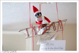 i knew i wanted to use the vintage model airplane that hangs from the ceiling in my son s room for an elf on the shelf day and my husband suggested that
