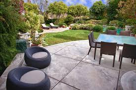 concrete exterior patio flooring options with square glass table rattan dining chairs two round padded