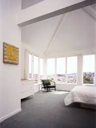 white carpet bedroom. this is an example of a contemporary bedroom in san francisco with white walls and carpet r