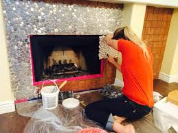 installing stainless steel aluminum or even copper tiles as a fireplace surround is a quick and lasting solution at a reasonable cost to renovate your