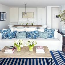 coastal living room rugs white sofa with blue pillows coastal living indoor outdoor rugs