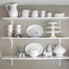 elegant white wooden kitchen floating shelves with iron cantilever attractive wall mounted kitchen shelves ideas