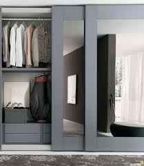 whole wall sliding closet doors with grey frames for a masculine well organized closet space