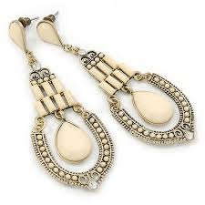 vintage inspired cream acrylic bead chandelier earrings in antique gold tone met