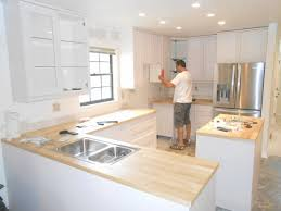 assembling ikea kitchen cabinets. Wonderful Cabinets Installing Ikea Kitchen Cabinets Yourself Luxury Average Cost Within  Installed For Assembling T