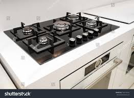 modern gas stoves. Gas Stove With And Embedded Electric Oven At Brand New Modern White Kitchen Stoves