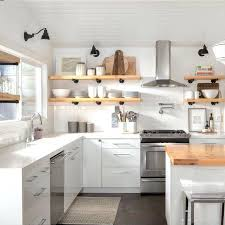 modern kitchen floating shelves a clean white minimalist kitchen with light wood floating shelves light wood