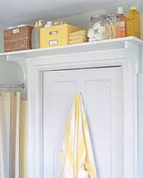 Love this shelf-above-door idea for extra storage in a bathroom