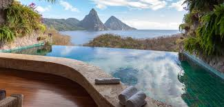 infinity pools edge. This Infinity Pool Has A Stone Retaining Wall That Protects The Rich Wood Patio From Any Pools Edge