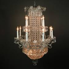 oversized vintage french chandelier features twelve scrolled arms terminating in candle lights strung cut crystal