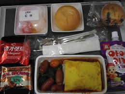 Seoul to Singapore Omurice with cocktail sausages spinach fruit  cookies a muffin bread bun and fruit juice