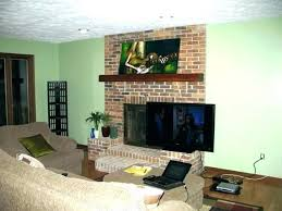 can you mount a tv over a fireplace hang over fireplace mounting over fireplace full size