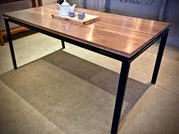 handcrafted metal base with divided wooden top table  arthaus