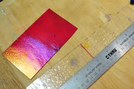 step one cut out both your top and bottom piece of glass i ll be using a red iridescent glass for the top layer of my project
