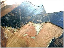 beautiful woman puts laminate flooring removing vinyl floor tiles from wood how to remove concrete