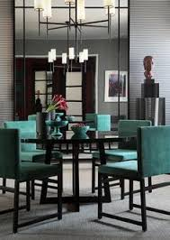 modern dining room with beautiful turquoise chairs