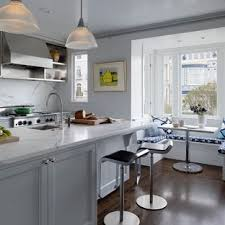 Large Transitional Galley Dark Wood Floor Eatin Kitchen Photo In San  Francisco With White Cabinets Marble Countertops O5