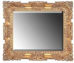 large gold ornate rectangular mirror