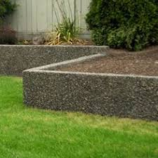 Small Picture Stucco is applied to the sides of the raised bed Or add glass
