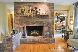 interior modern mount lcd tv on grey brick fireplace and white frame also black frame